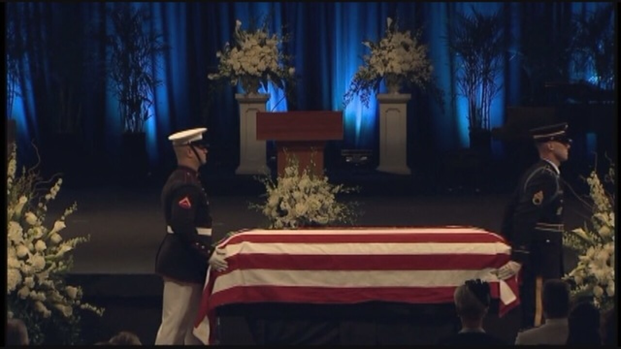 Friends, political rival say goodbye to McCain
