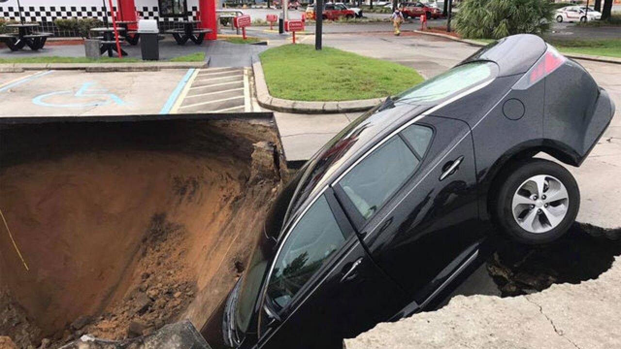 Sinkhole Swallows Car In Florida Restaurant Parking Lot