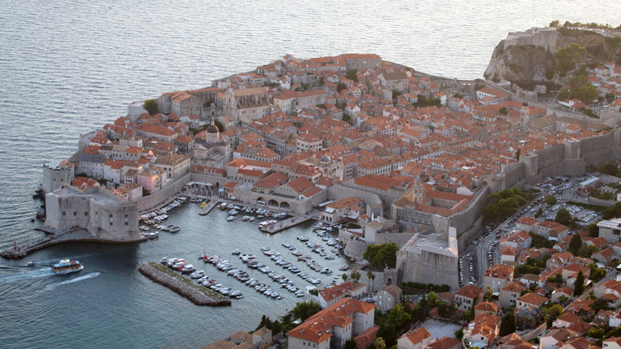 This Sept. 4, 2018 photo shows the old town of Dubrovnik from a hill above the city. Crowds of tourist are clogging the entrances into the ancient walled city, a UNESCO World Heritage Site, as huge cruise ships unload thousands more daily.