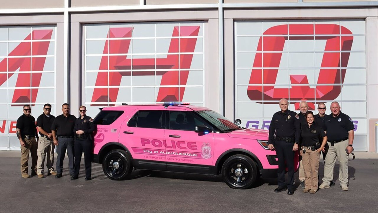 A police department paints a patrol car pink for Breast Cancer Awareness Month
