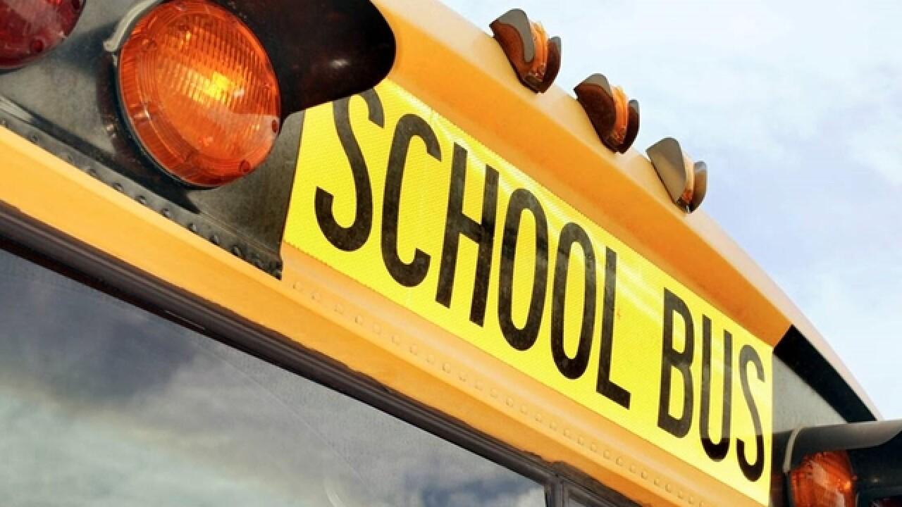 6 hospitalized after crash involving car, school bus