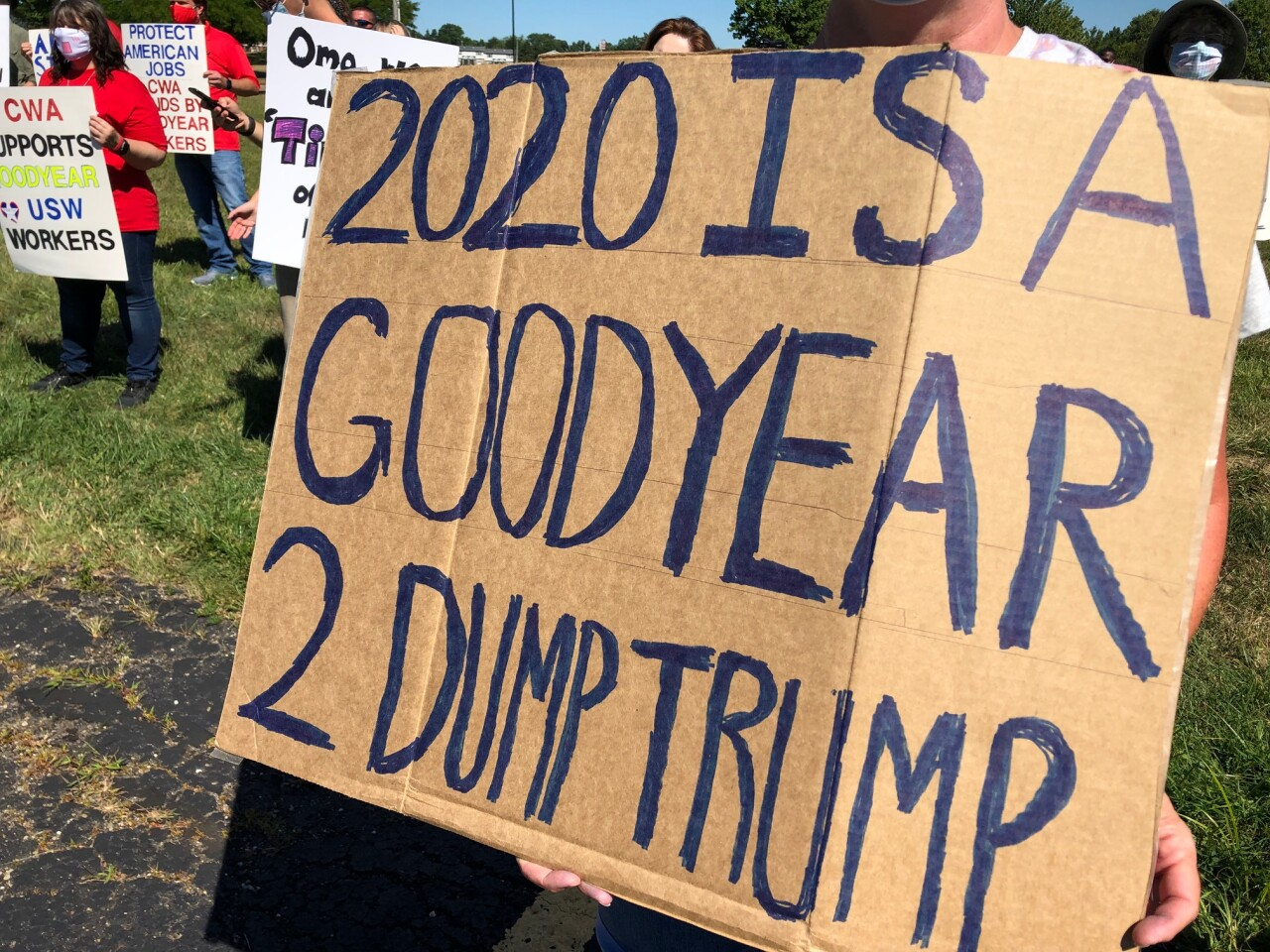 Workers come out to rally against President Trump's call to boycott Goodyear Tire and Rubber Company.