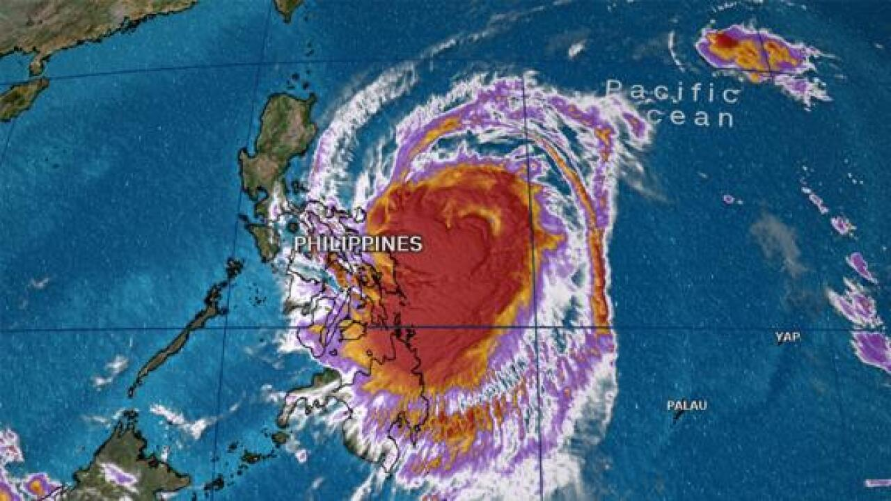 Thousands evacuated as typhoon strengthens and makes landfall in Philippines