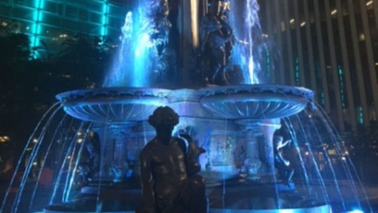 Who are the people behind the figures on the Tyler Davidson Fountain in downtown Cincinnati?