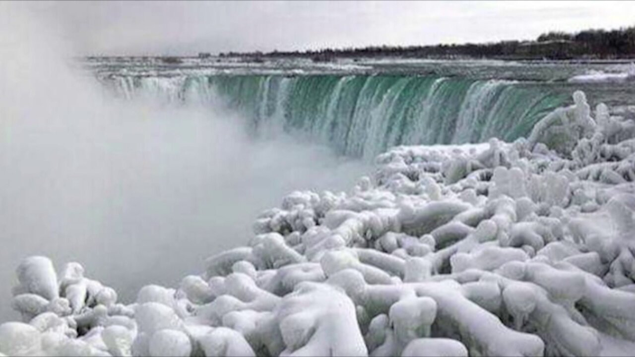 The usually rushing waters at Niagara Falls have frozen — and visitors are stunned by the majestic views