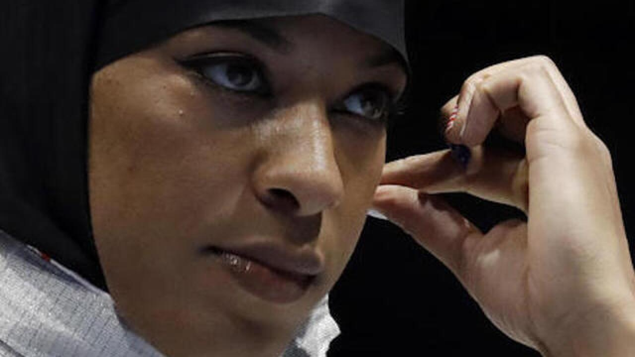 Ibtihaj Muhammad becomes first woman to compete in Olympics with hijab