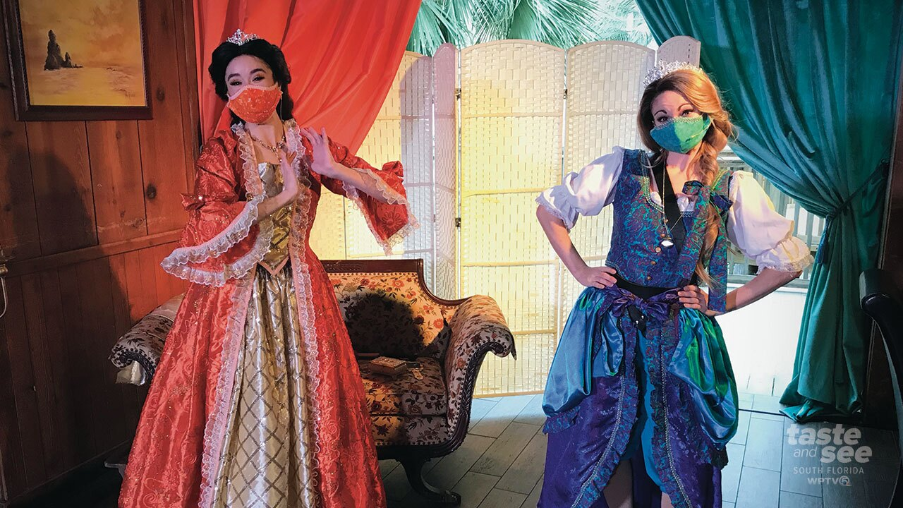 Two princesses pose at Gaylord Palms' Pirates and Princess Weekend in Orlando.