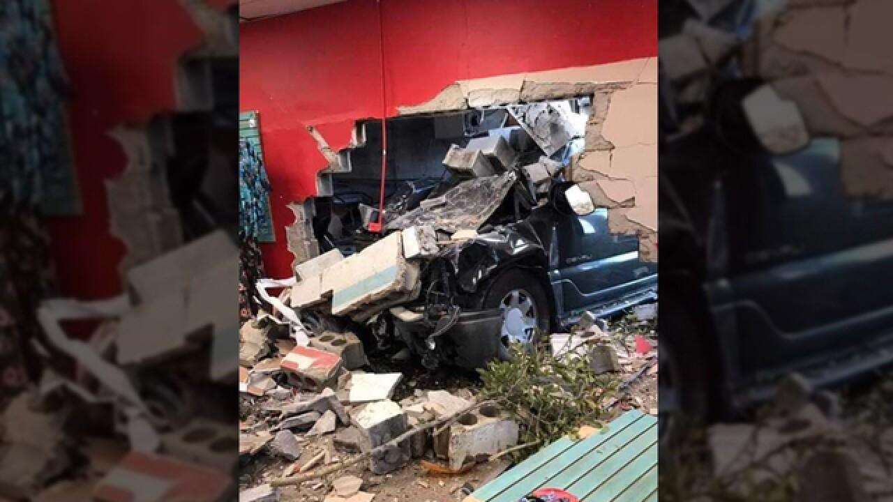 Image result for car crash into building