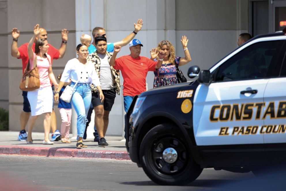Shoppers exit after a mass shooting at a Walmart in El Paso, Texas, Aug. 3, 2019 (Reuters).