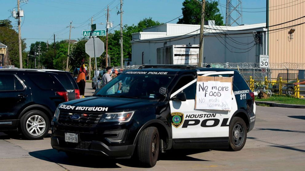 A sign on a police car lets passerby's know that there's no more food left a food distribution site at Reyes Produce April 13, 2020 in Houston, Texas.A sign on a police car lets passerby's know that there's no more food left a food distribution site at Reyes Produce April 13, 2020 in Houston, Texas. Mark Felix/AFP /AFP via Getty Images