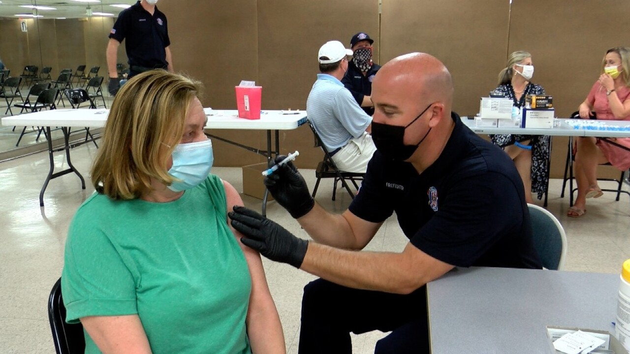 A patient receives the COVID-19 vaccine in Boynton Beach on April 7, 2021.jpg
