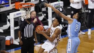 Florida State Seminoles guard Scottie Barnes drives to basket vs. North Carolina Tar Heels forward Armando Bacot in 2021 ACC Tournament