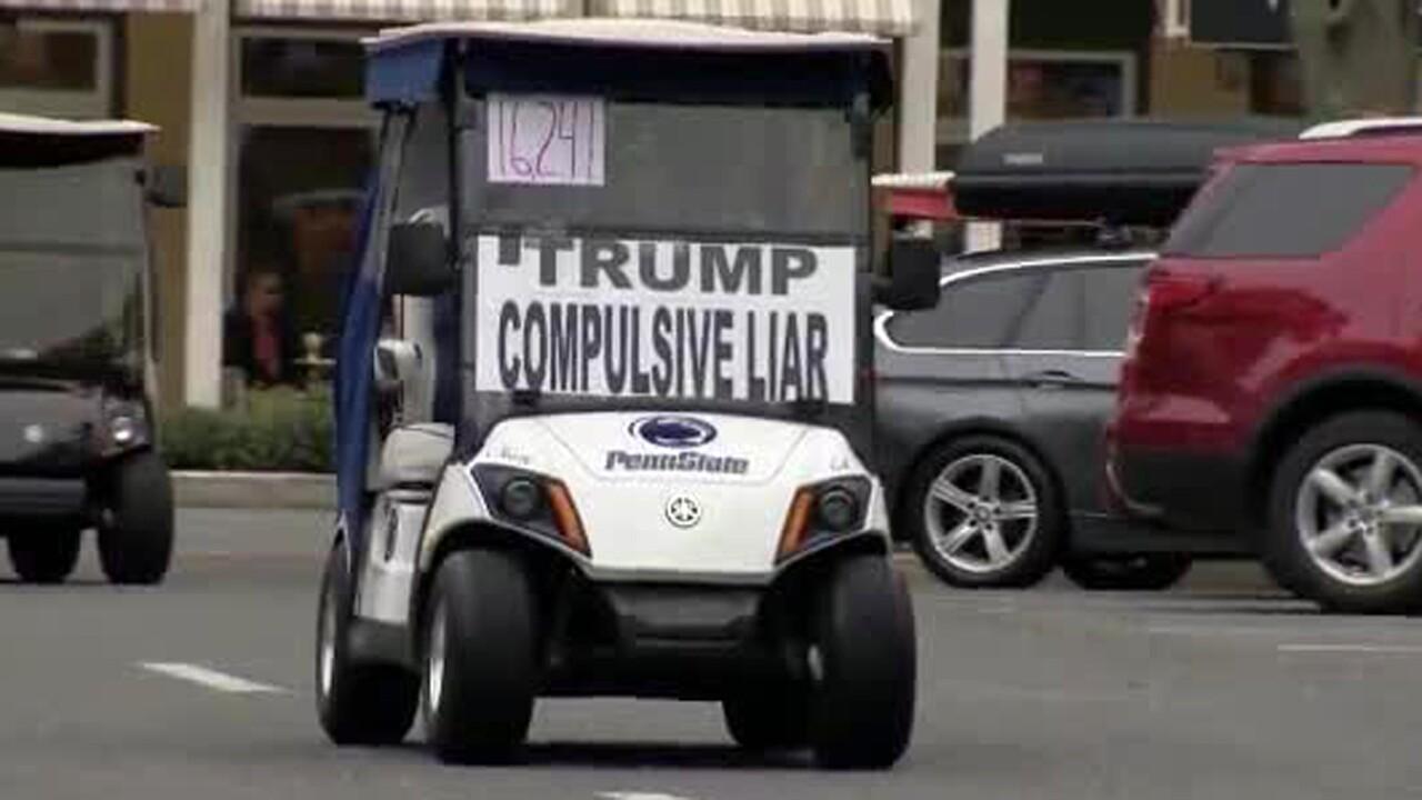 wptv-anti-trump-golf-cart.jpg