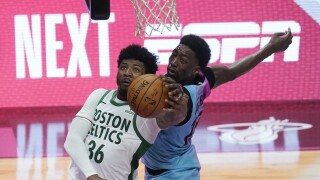Miami Heat center Bam Adebayo blocks shot by Boston Celtics guard Marcus Smart, Jan. 6, 2021