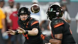 Miami Hurricanes QB Tyler Van Dyke tosses football to Jaylon Knighton vs. NC State Wolfpack in 2021