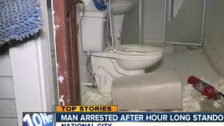 Police capture intruder holed up at National City home