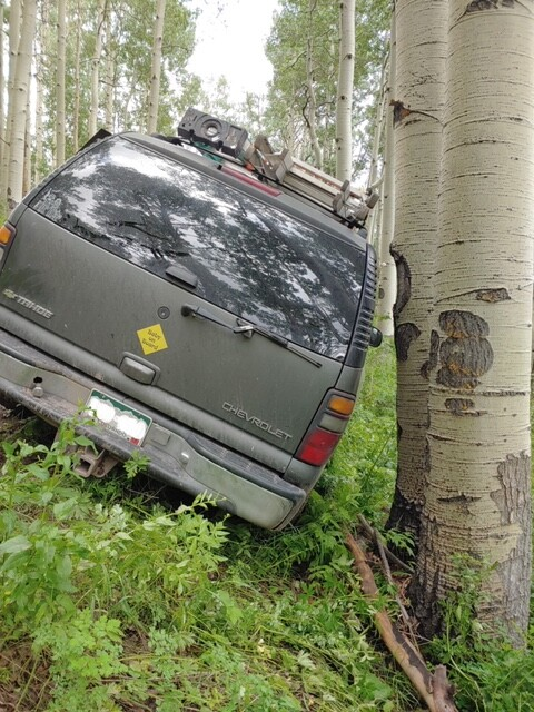 SUV slides off road