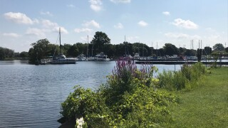 Man's body found floating in MuskegonLake