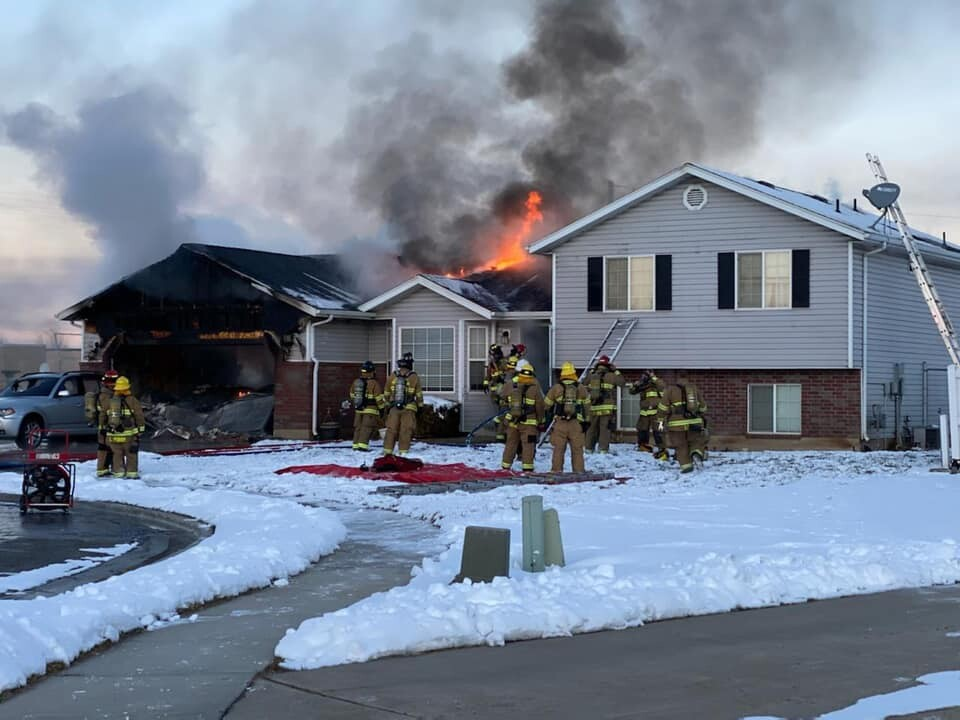 Photos: Firefighters extinguish fire at Harrisvillehome