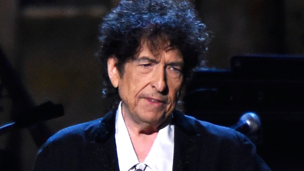 Bob Dylan playing at Red Rocks in June