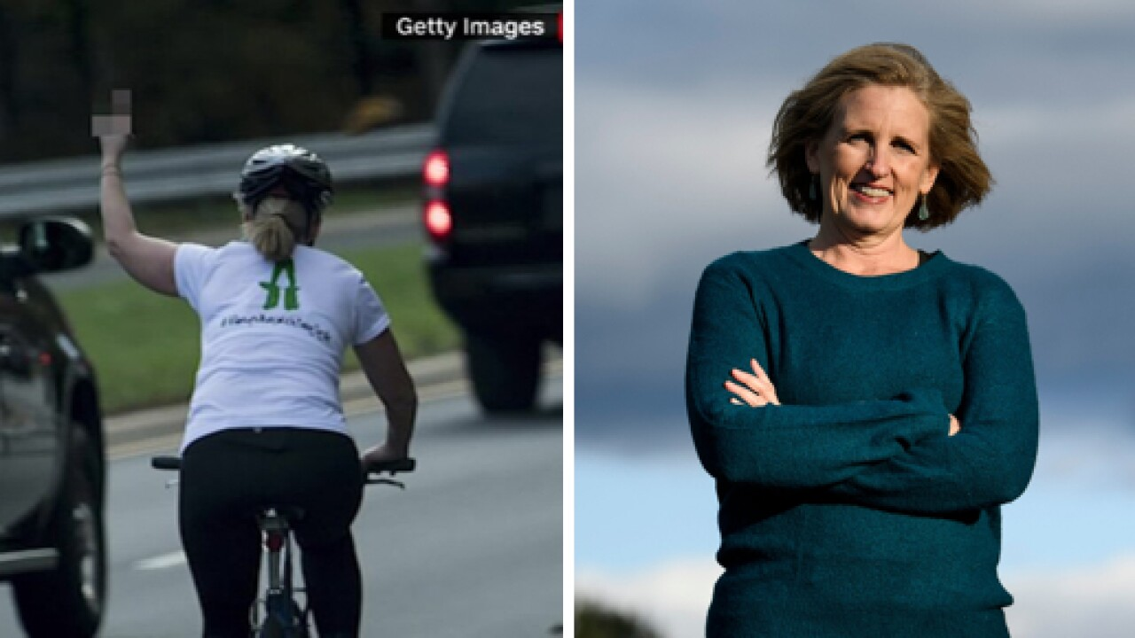 Cyclist who lost job for flipping off Trump motorcade wins local office in Virginia