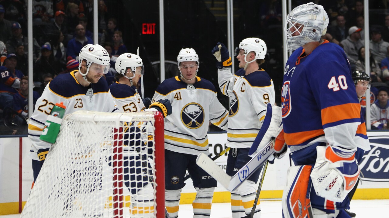 UNIONDALE, NEW YORK - MARCH 30: Victor Olofsson #41 of the Buffalo Sabres (3rd from left) celebrates is first NHL goal against Robin Lehner #40 of the New York Islanders at NYCB Live's Nassau Coliseum on March 30, 2019 in Uniondale, New York. The Islanders defeated the Sabres 5-1 to qualify for the playoffs. (Photo by Bruce Bennett/Getty Images)