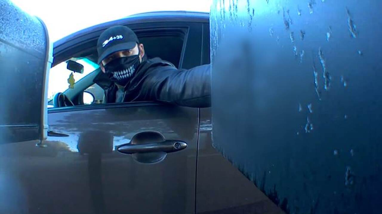 Masked man opens two mailboxes