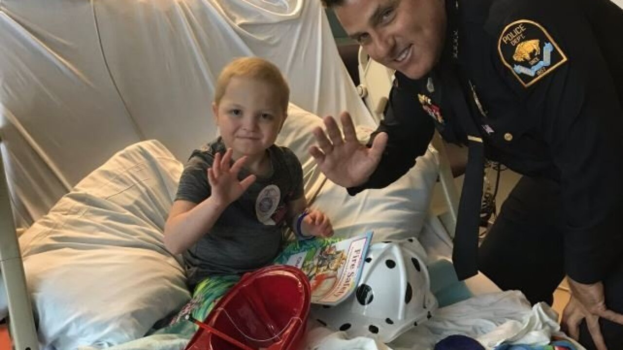 Omaha Police and Fire bring smiles to pediatric hospital patients