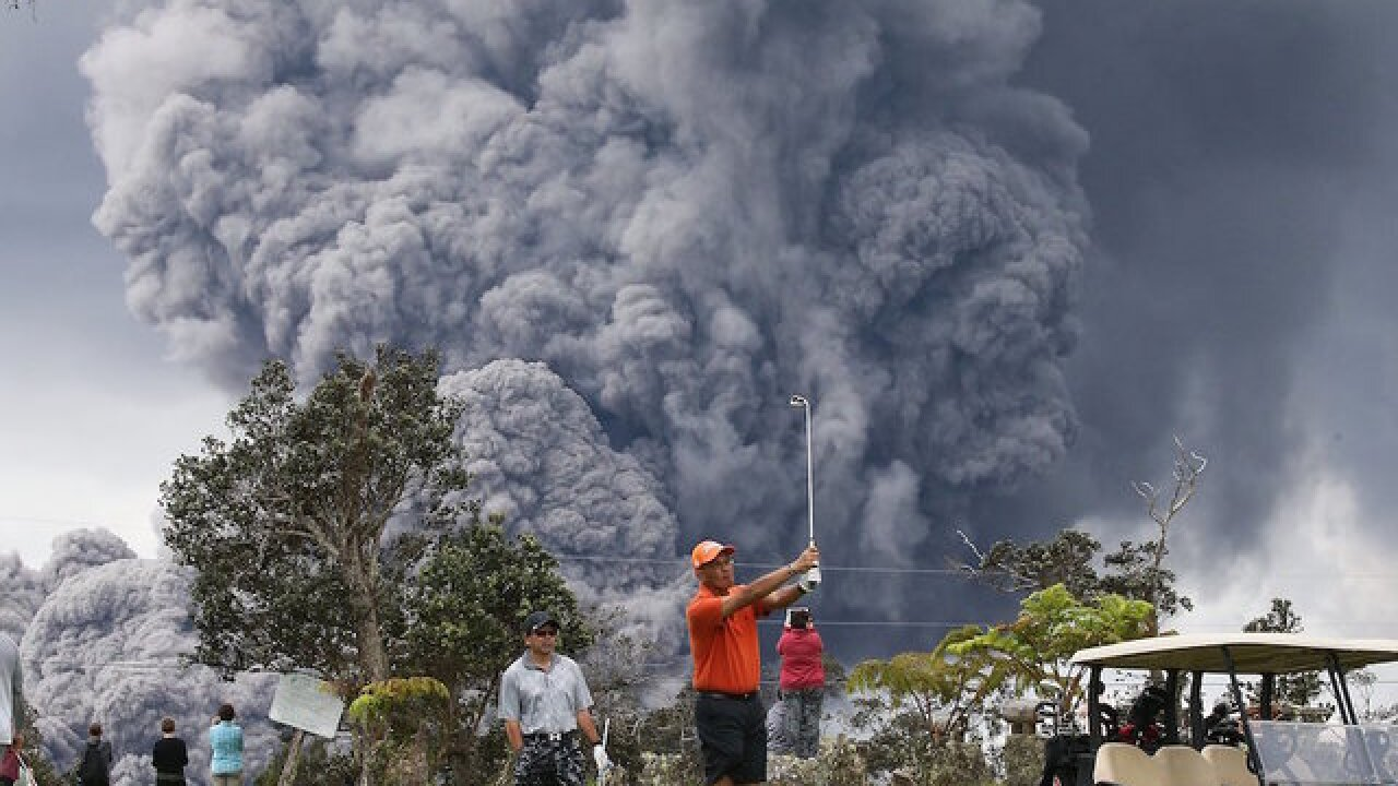 Volcanic eruption can't ruin a day on the golf course