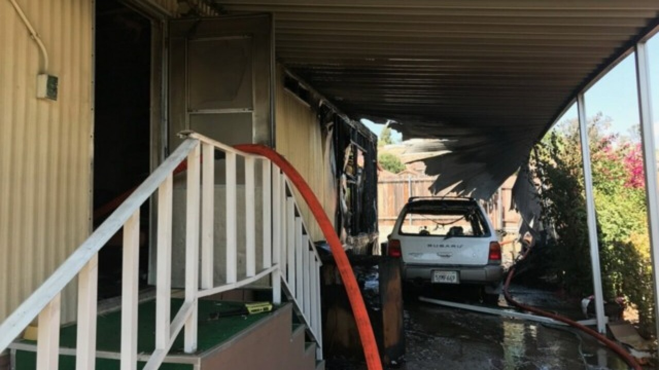 Neighbors save woman and dog from fire