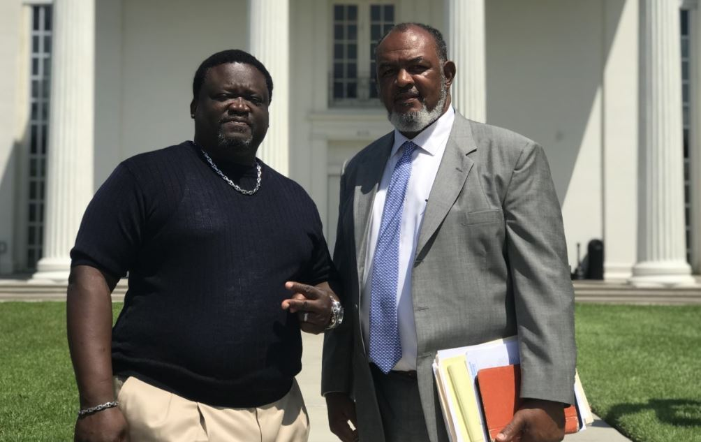 Lawrence Mitchell, left, and his attorney John Milton of Lafayette
