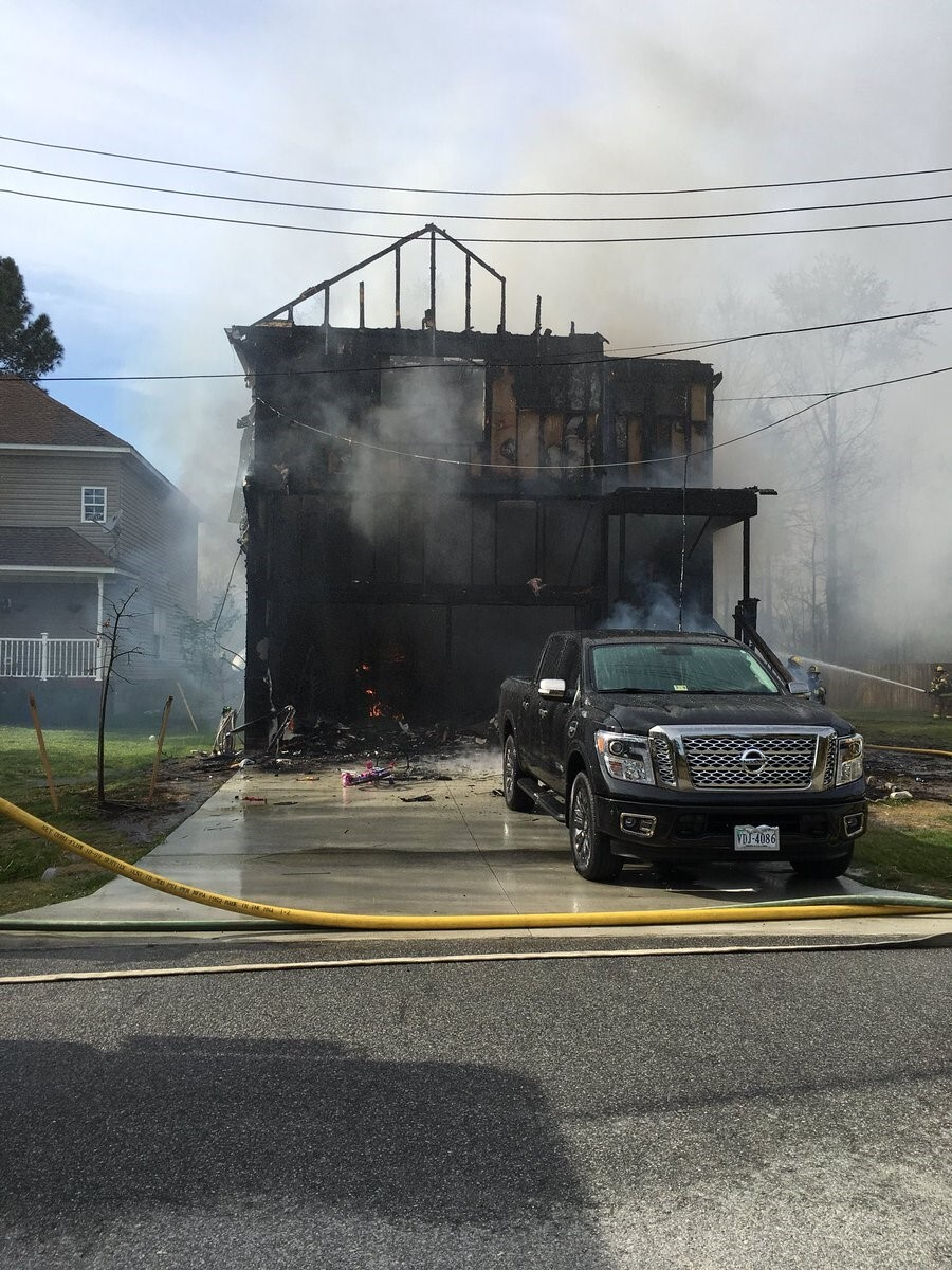 Photos: Family of four displaced after Chesapeake housefire