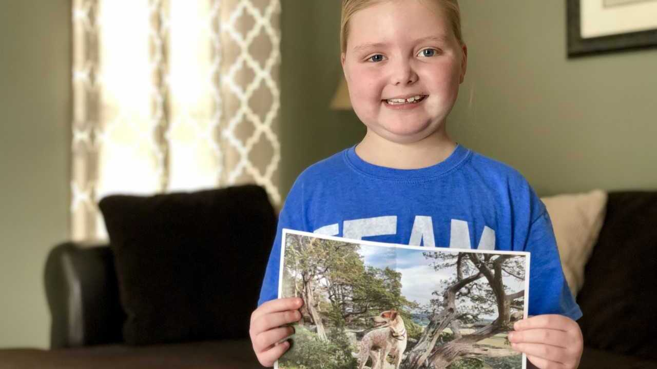 Emma of Hartland holds up a picture of a dog sent to her