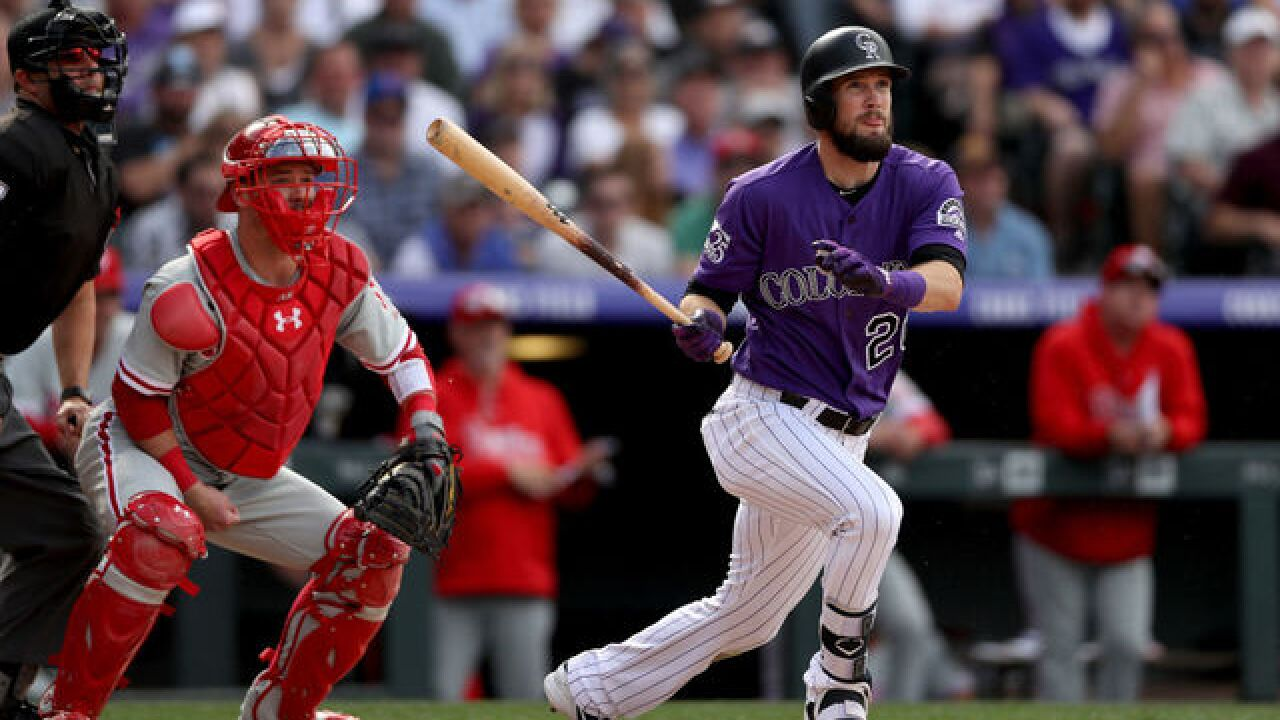 Dahl homers in 4th straight, Rockies open 1-game lead with 3 games to go