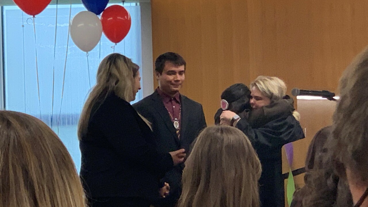 Drug Court graduate Amanda Boyer hugging Yellowstone Co. District Judge Mary Judge Knisely after Treatment Court graduation