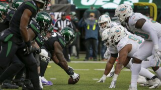 Miami Dolphins and New York Jets line up, December 2019