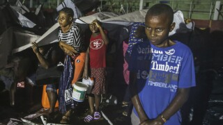 Children affected by Haiti earthquake take shelter in refuge camp