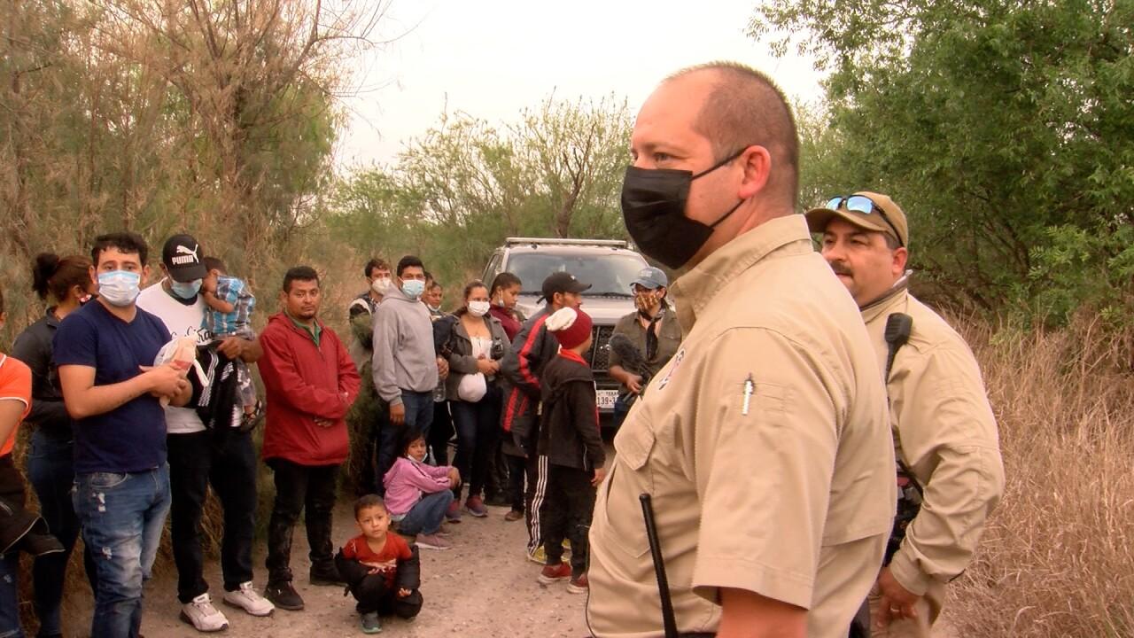 migrants and deputies.jpg