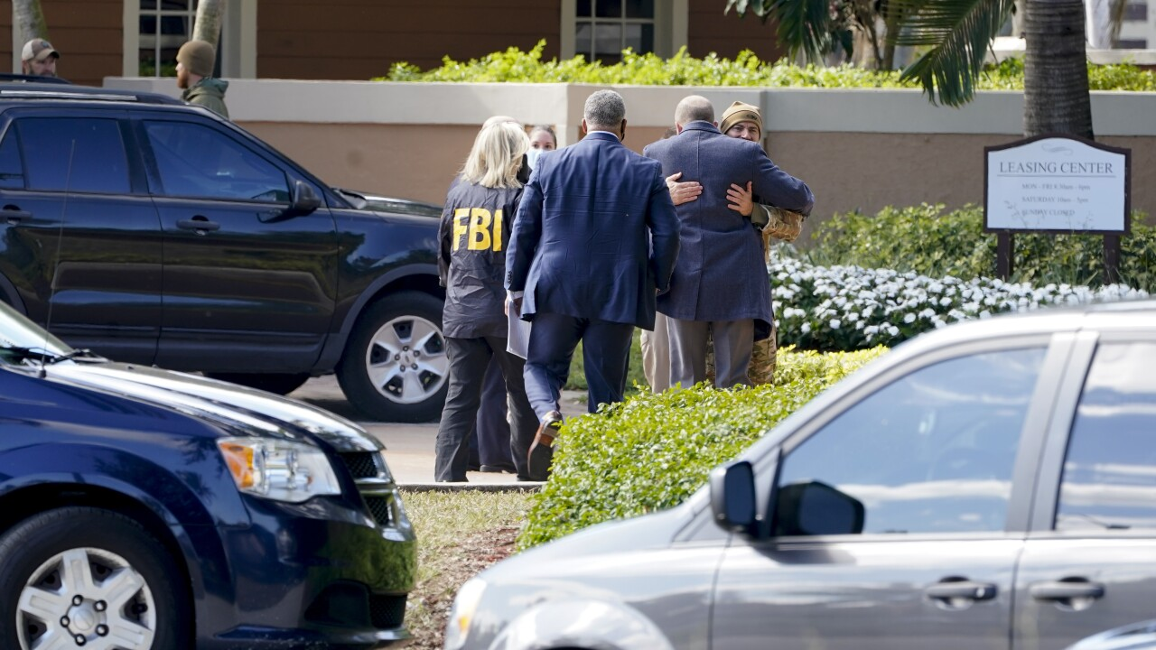 Law enforcement embrace outside scene of FBI shooting in Sunrise
