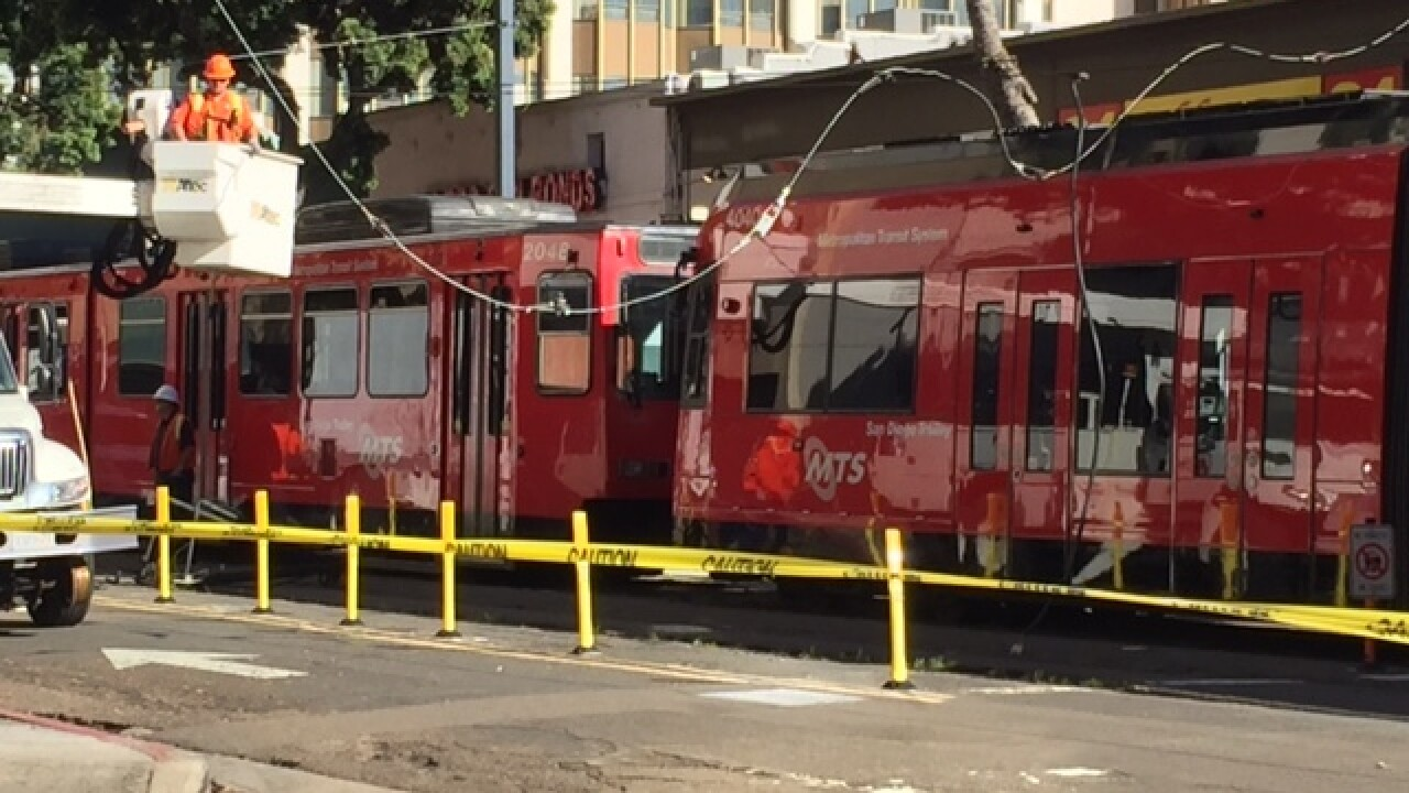 Downed power line halts downtown trolley service