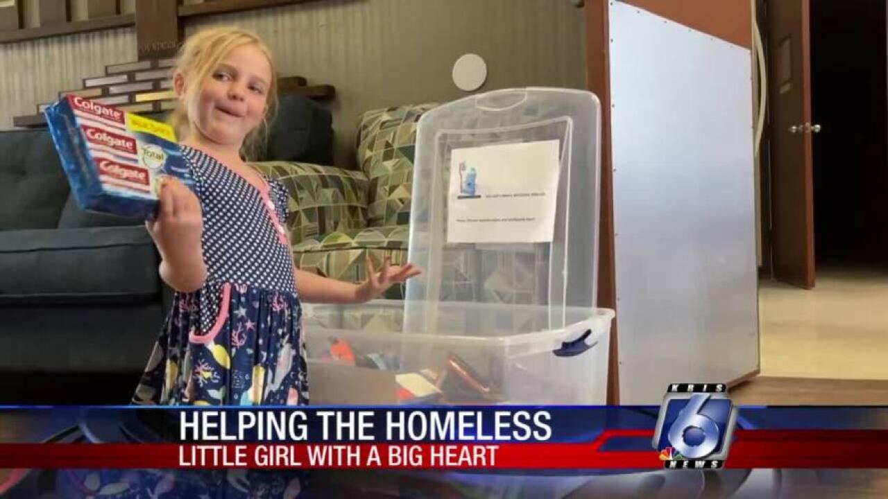 Preschooler collecting dental supplies for homeless