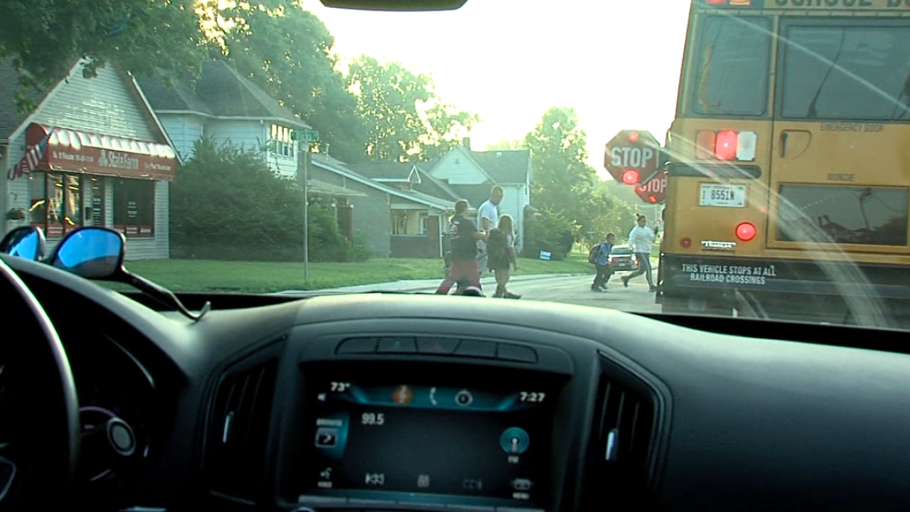 Indiana police follow school buses.PNG