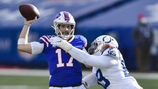 Buffalo Bills QB Josh Allen throws as Indianapolis Colts defensive tackle DeForest Buckner in wild-card playoff game, Jan. 9, 2021