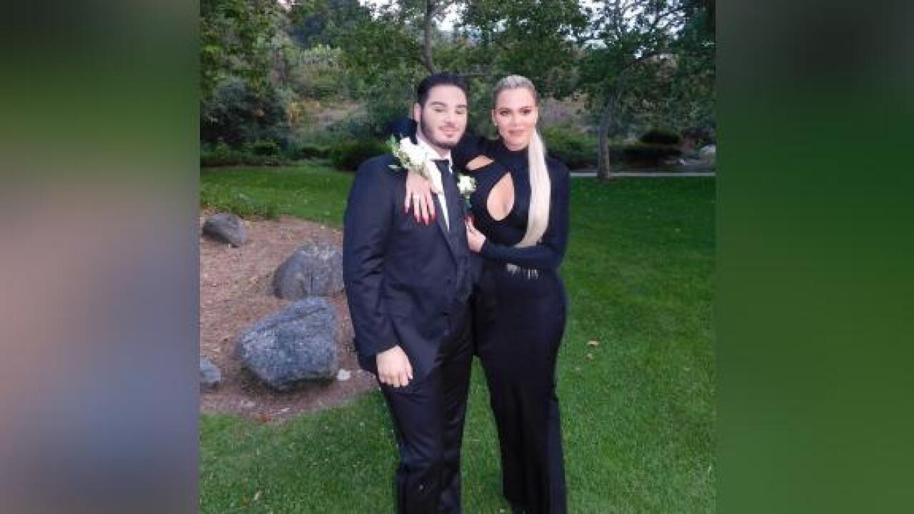 Khloe Kardashian attends her first prom with a fan