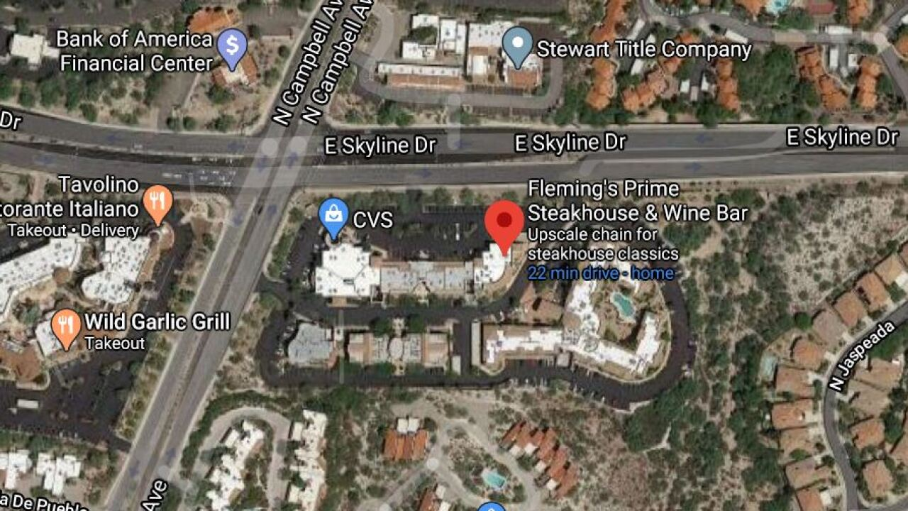 According to a company spokesperson, a worker at Fleming's Prime Steakhouse & Wine Bar, 6360 N. Campbell Ave., tested positive for coronavirus. Photo via Google Maps.
