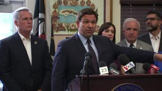 Gov. Ron DeSantis speaks as Rep. Kevin McCarthy listens during news conference in Hialeah Gardens, Aug. 5, 2021
