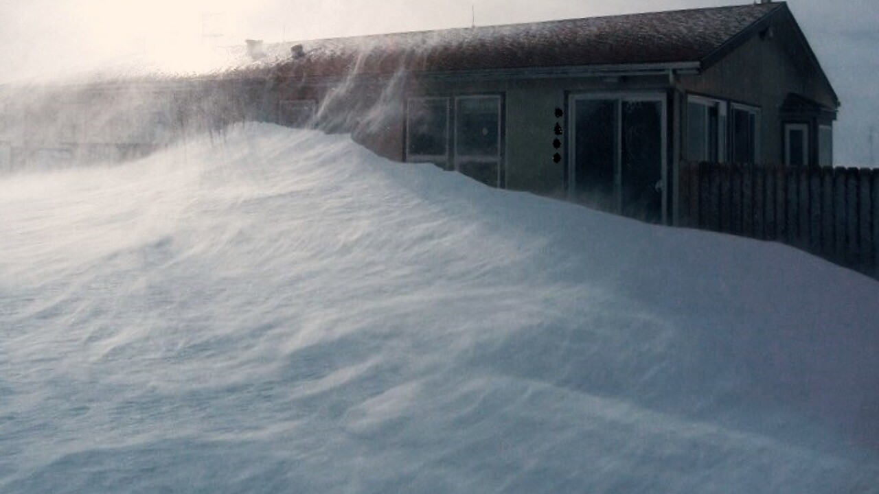Snow drifted to the roof of a house in Peyton by janine Coffman