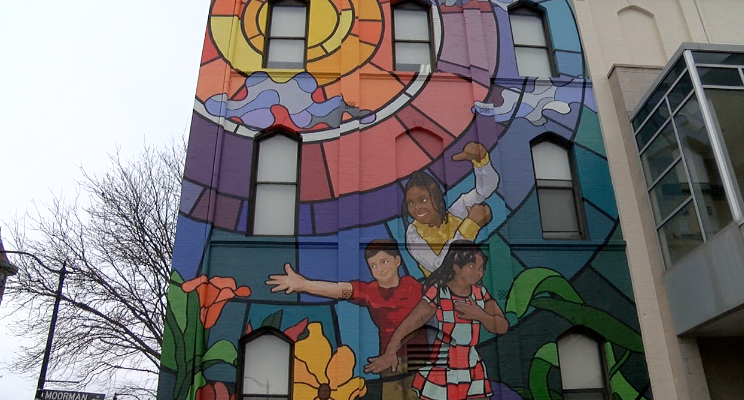 'Together We Win' painted on the St. Francis De Sales school in Walnut Hills by artist Brandon Hawkins