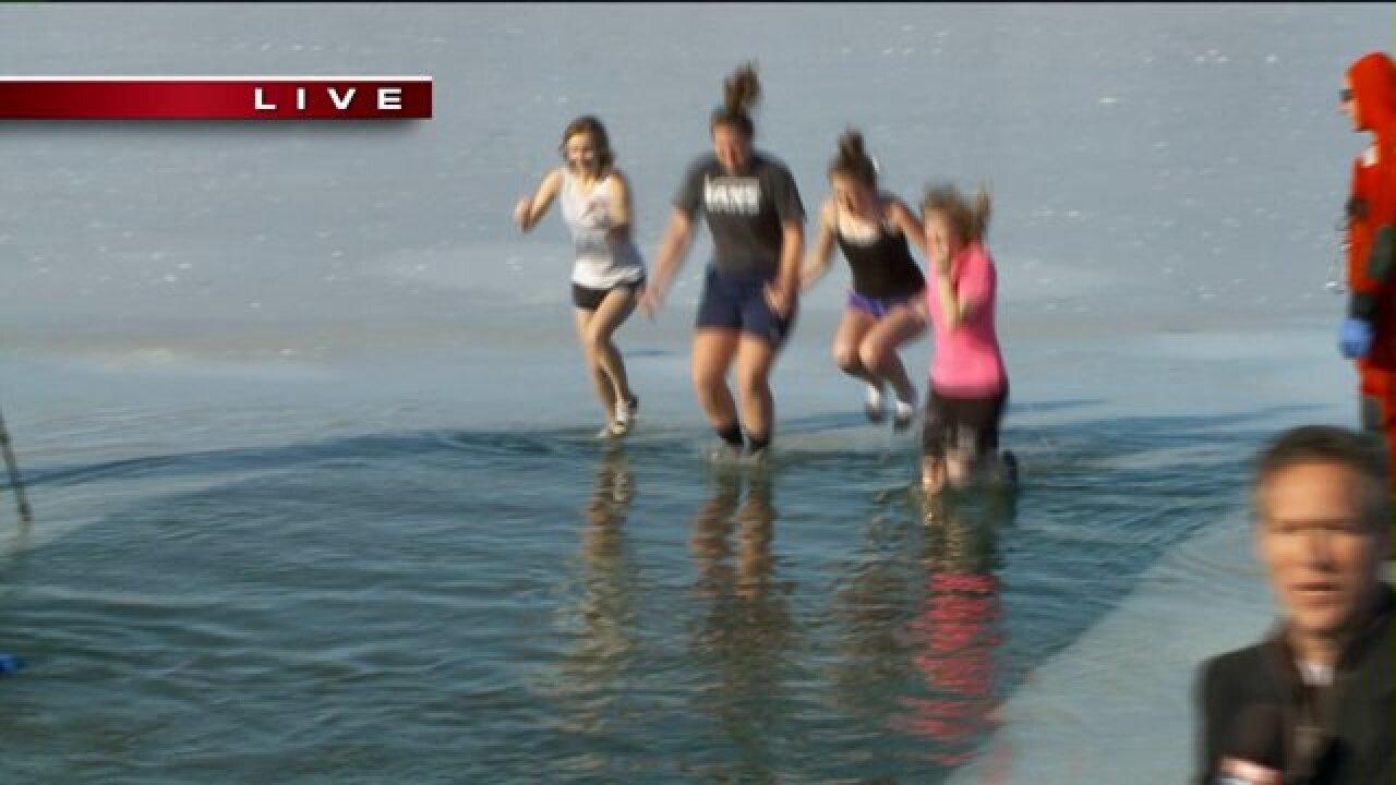 Tooele Co. residents jump into freezing lake for Polar Bear Plunge