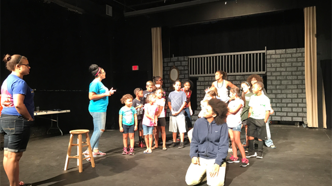 Young children participate in summer theater camp